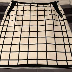 Beautiful knee length cream and black skirt. WHBM